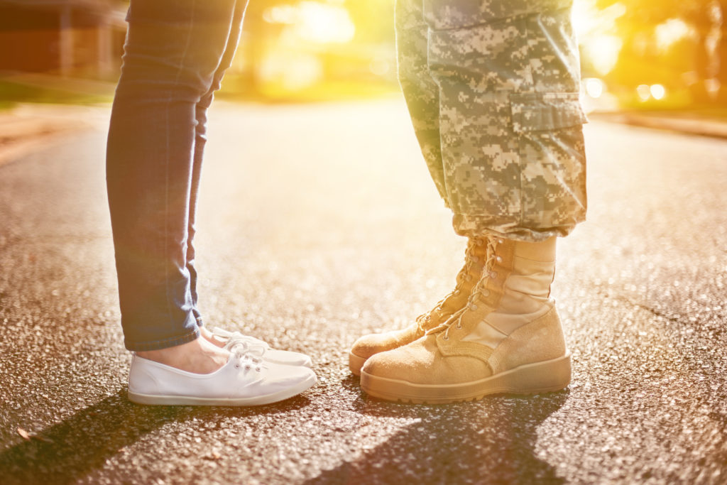 military couple kissing each other
